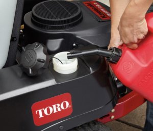 adding fuel to a mower